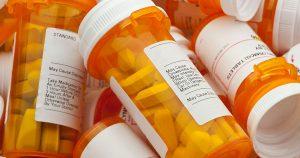Pill bottles in a pile
