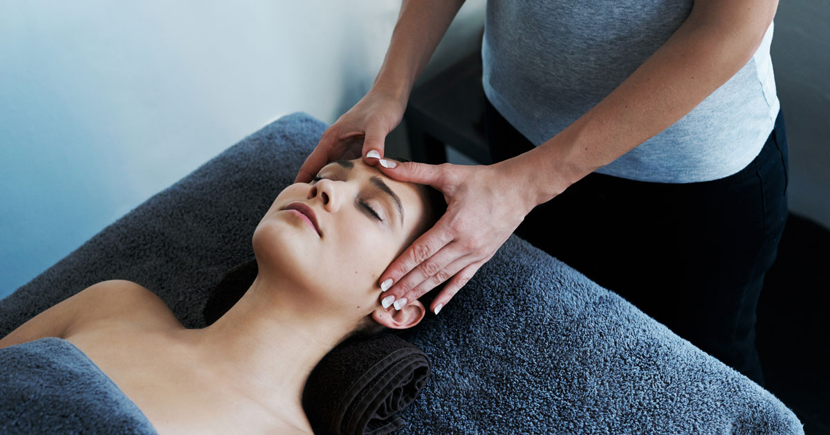 Woman getting her temples massaged