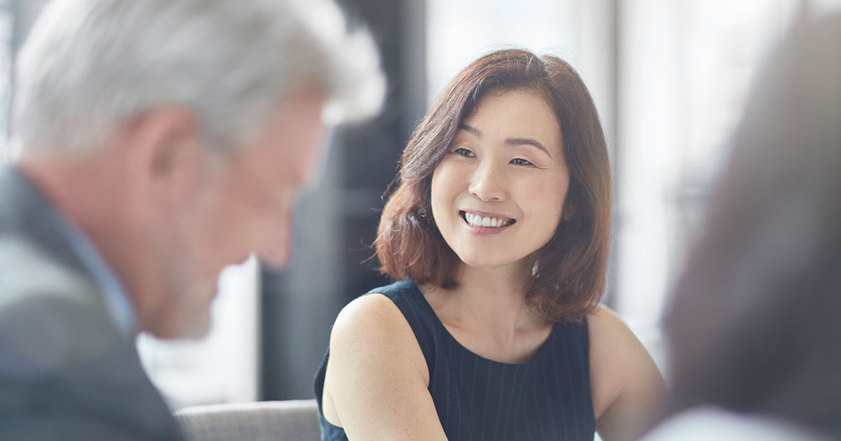 Smiling businesswoman looking at colleague