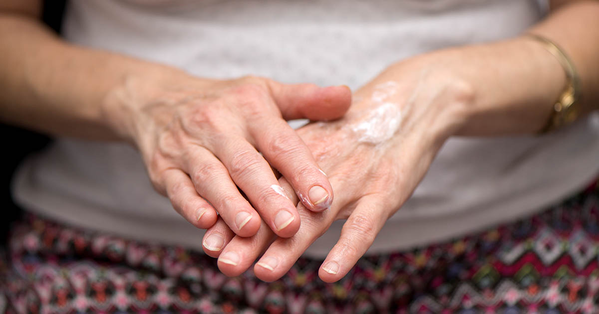 Senior woman's hands with cream