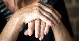 Elderly hands folded on top of one another