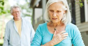 Elderly woman experiencing shortness of breath
