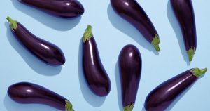 Eggplants on blue background