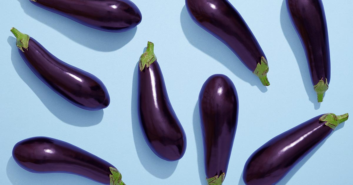 Eggplants on blue background
