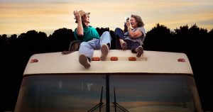 Couple on the rooftop of a car camper