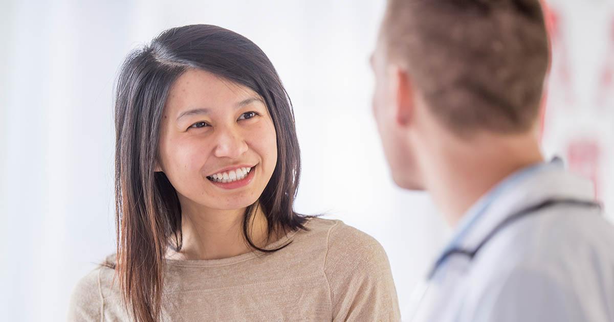 Woman smiling at a man